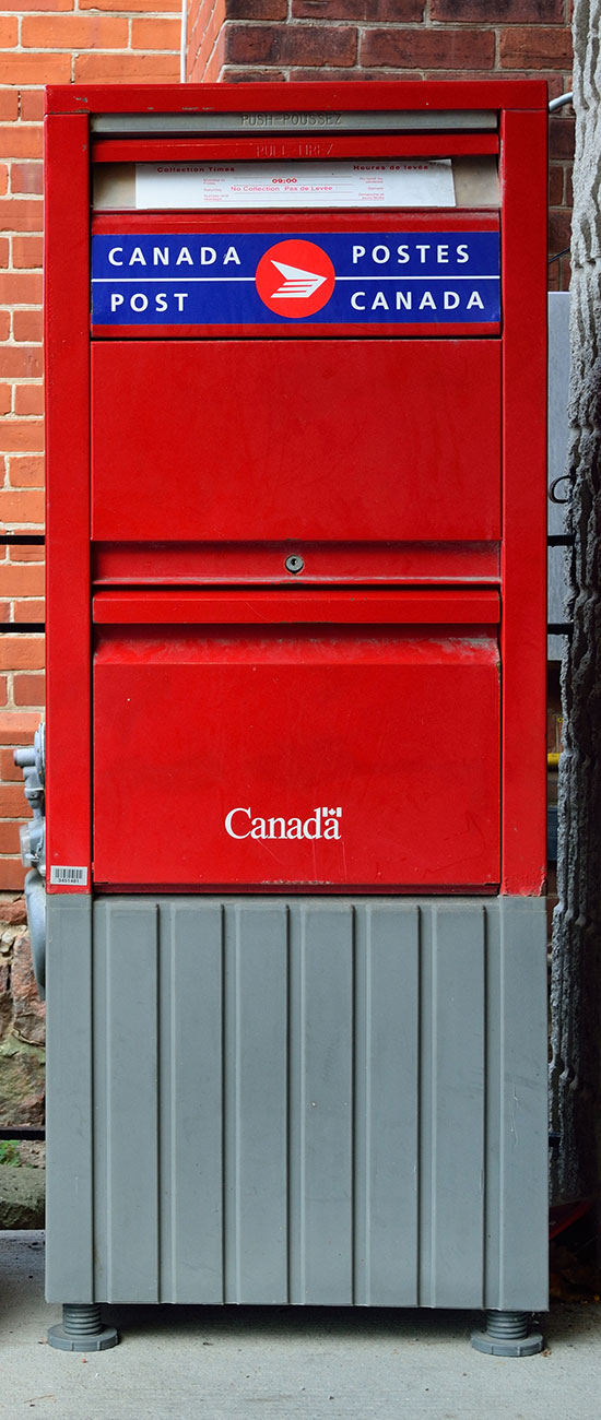 Red and rectangular Post Canada mailbox.