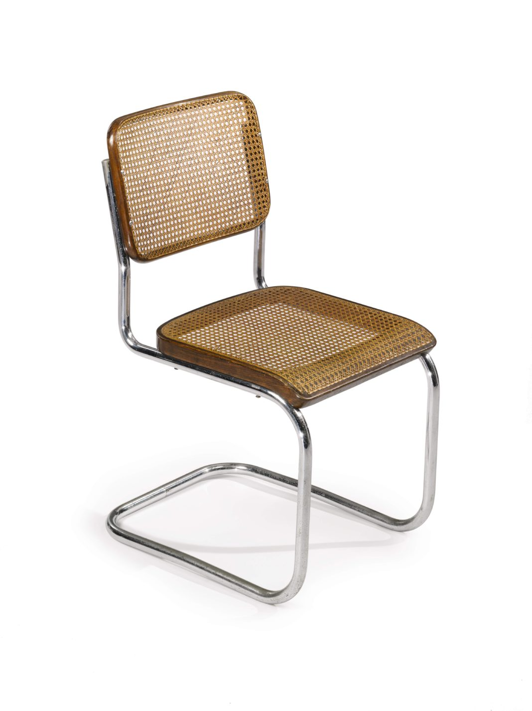 Cantilevered chair with a tubular steel frame and woven cane seat and back.