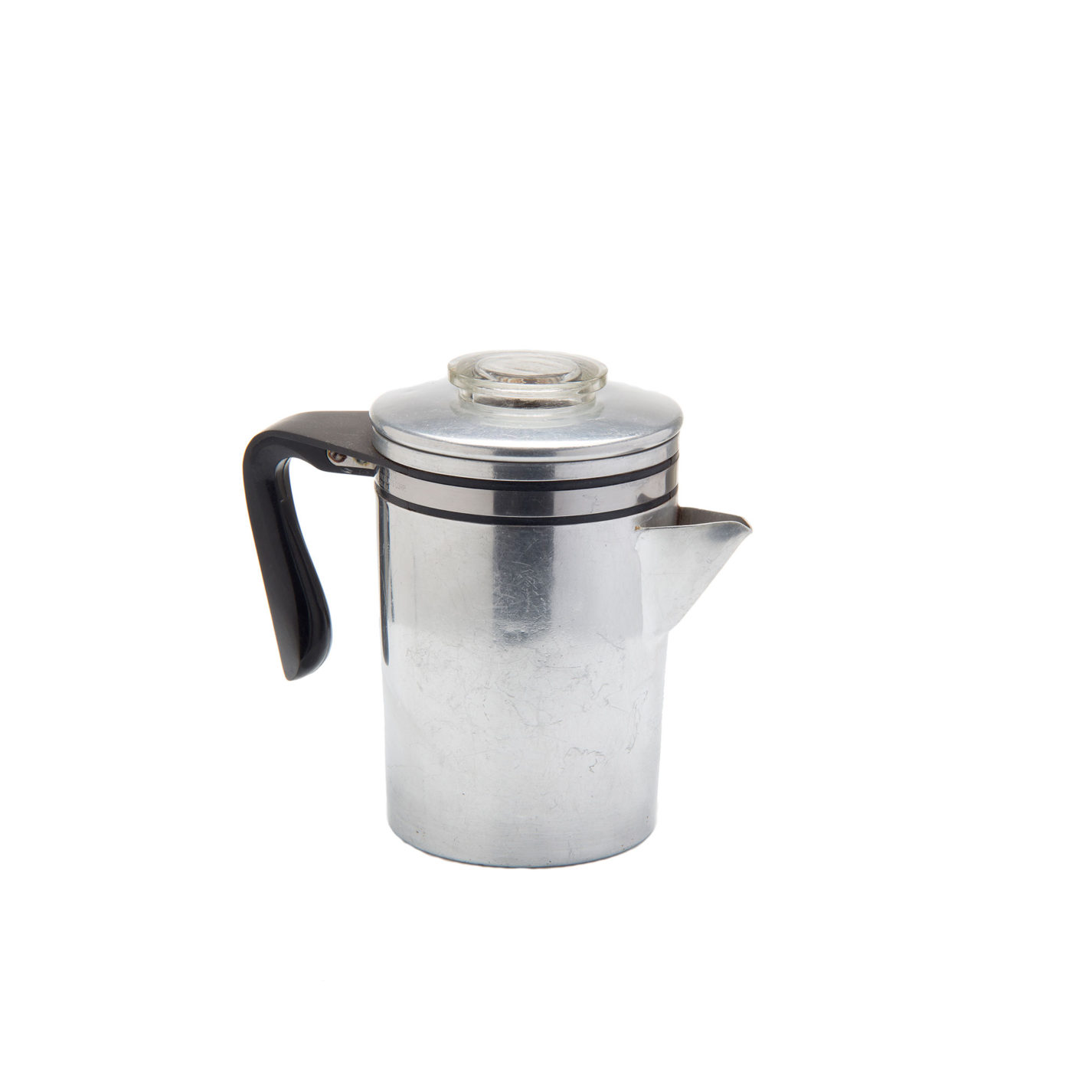 An aluminum coffeemaker. Its basic form is a cylinder with a triangular spout. A large black open handle is connected near the top. The lid has a glass disc on top for viewing the percolating coffee