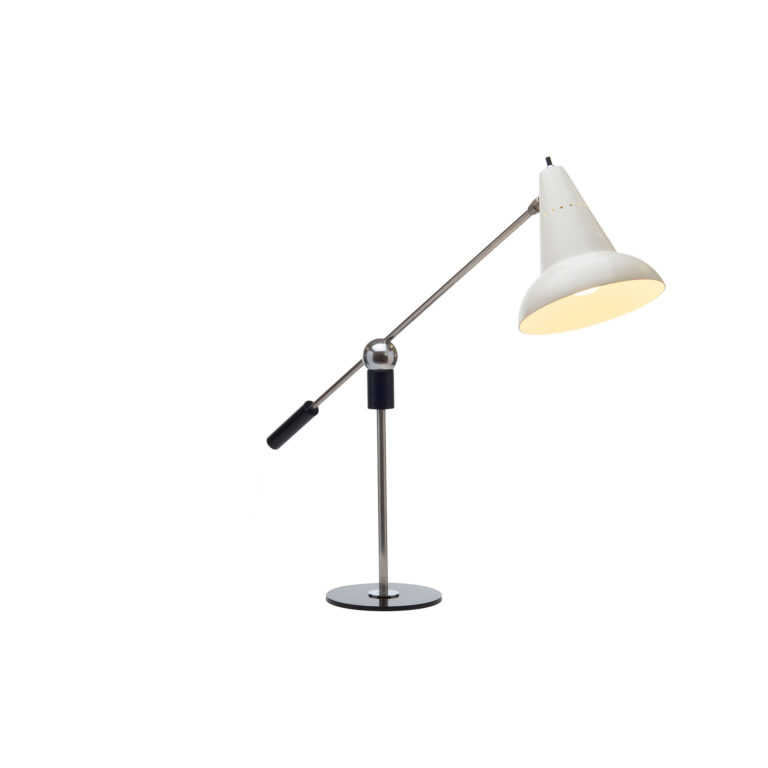 Table lamp made of two metal rods, one balanced atop the other, connected with a chrome sphere. At one end of the balanced rod is a cylindrical black weight and at the other end is the light source with a cone-shaped shade in white metal.