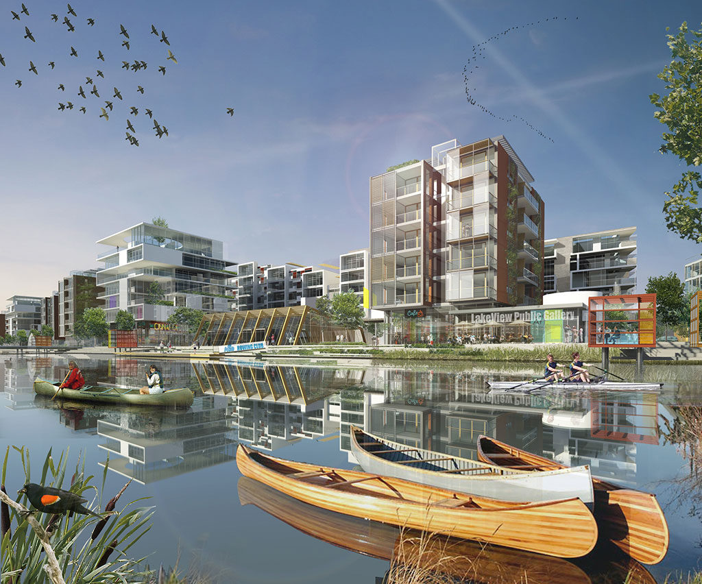 Residential development of rectangular, modern buildings of several stories each next to the water.
