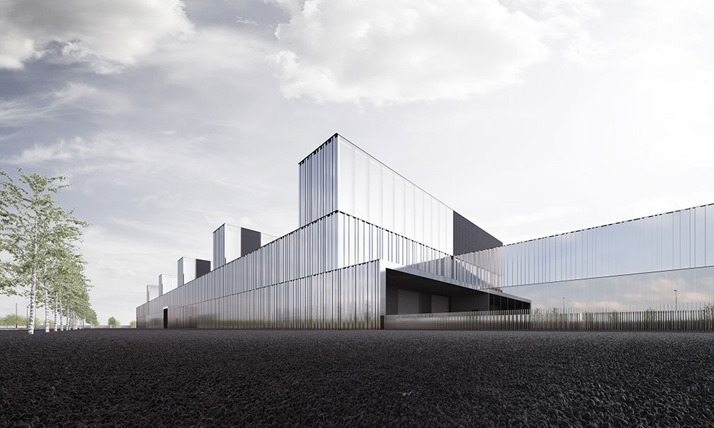 Long, low geometric building covered in corrugated aluminum and mirrored glass.
