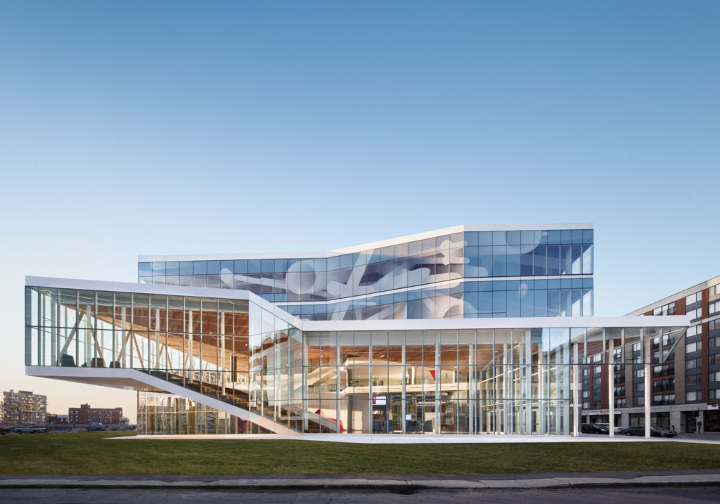 Angular multilevel building of glass and steel, cantilevered on one side.