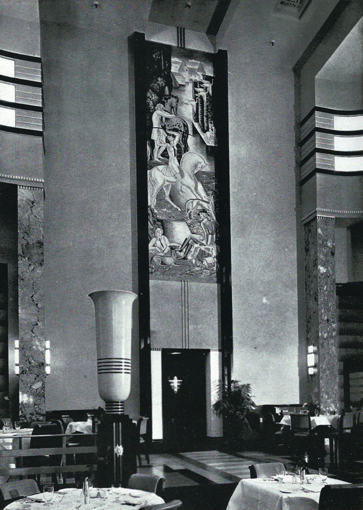 Art deco restaurant interior with high ceilings. A mural adorns the vertical space above an elevator with a classical urn in the foreground.
