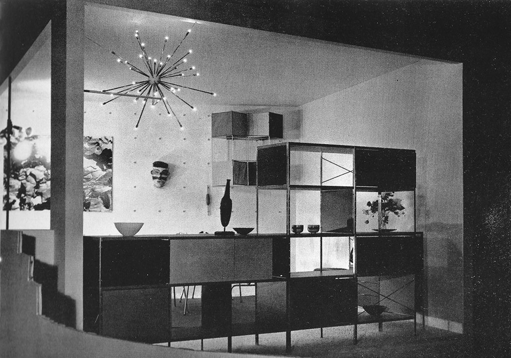 Black-and-white exhibition installation view showing and arrangement of ESU modular cabinets and small housewares.