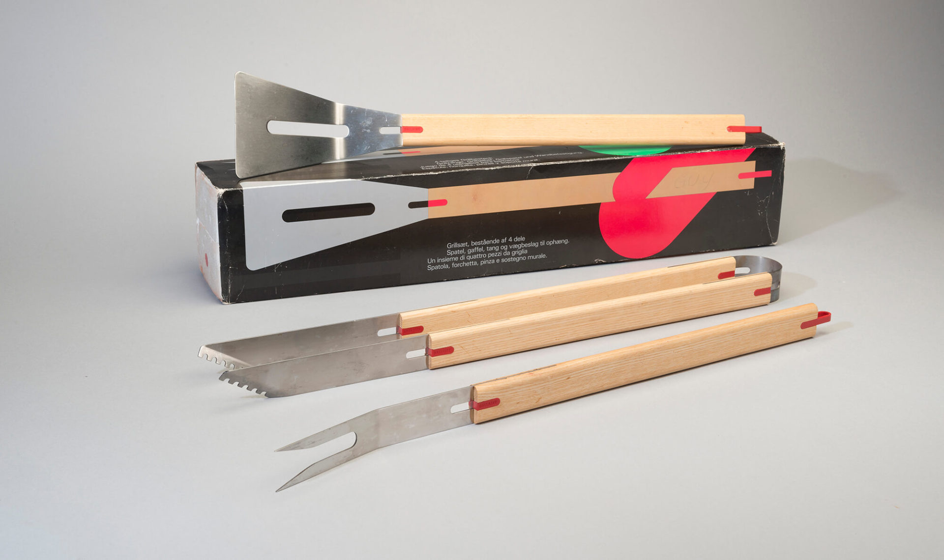 Set of metal barbecue tools with wooden handles.