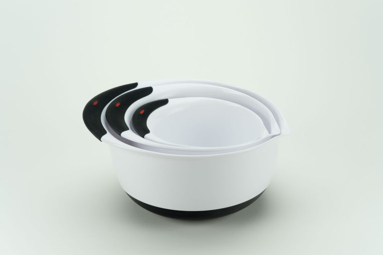 Set of nested mixing bowls. Each bowl is white plastic with black rubber on its handle and base.