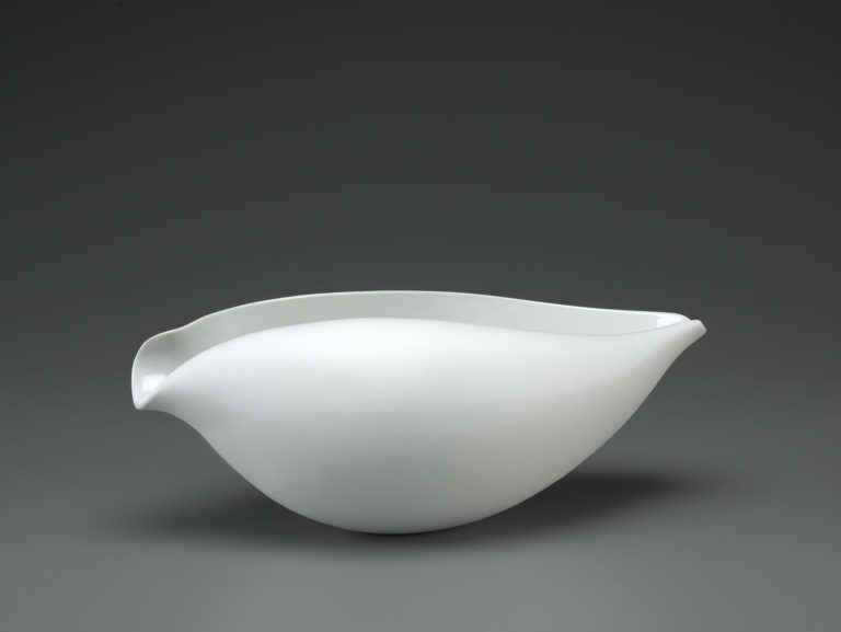 Oblong bowl that curls inward at the top, resembling a seashell.