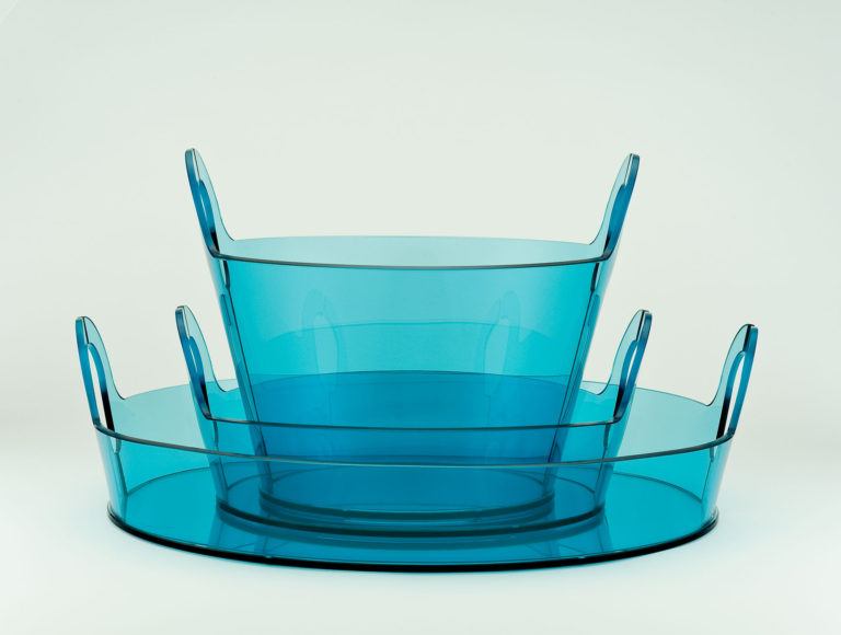 Set of circular nesting baskets of transparent blue glass in different sizes and proportions.