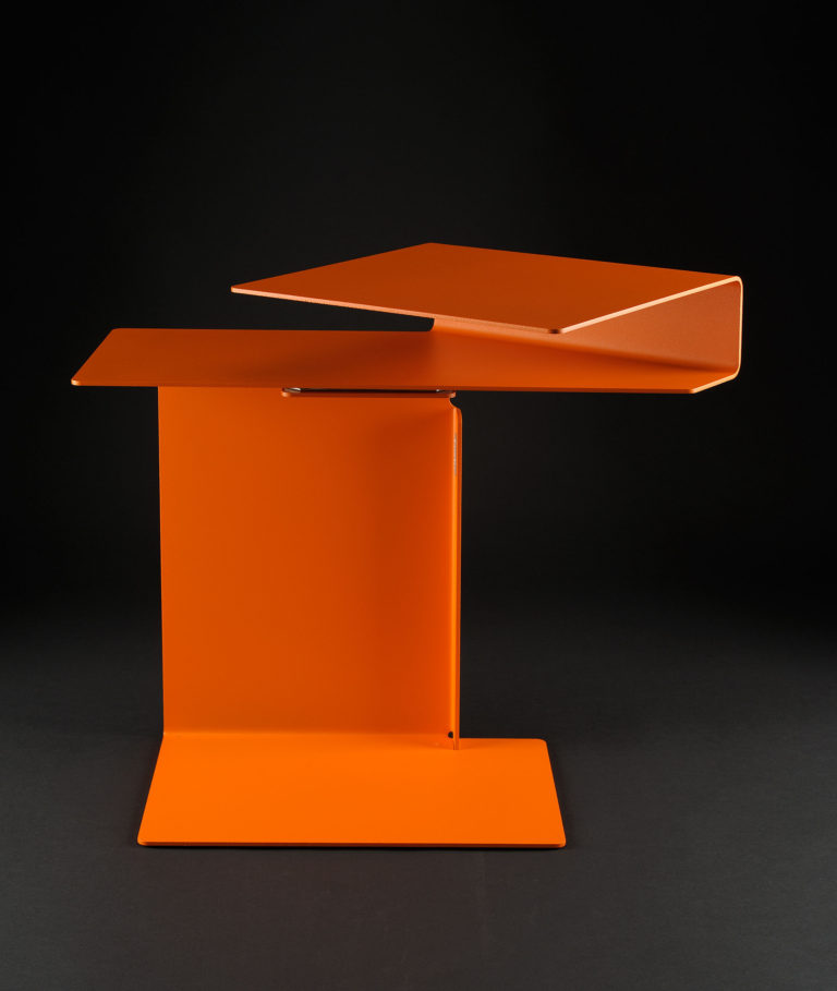 Small table made of bent orange sheet metal.