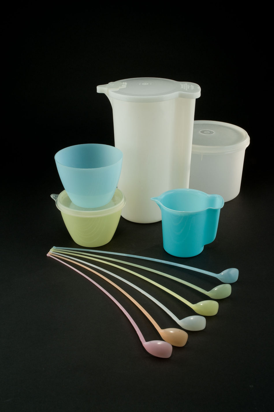 Set of translucent plastic bowls, pitchers, and spoons in different sizes and colors.