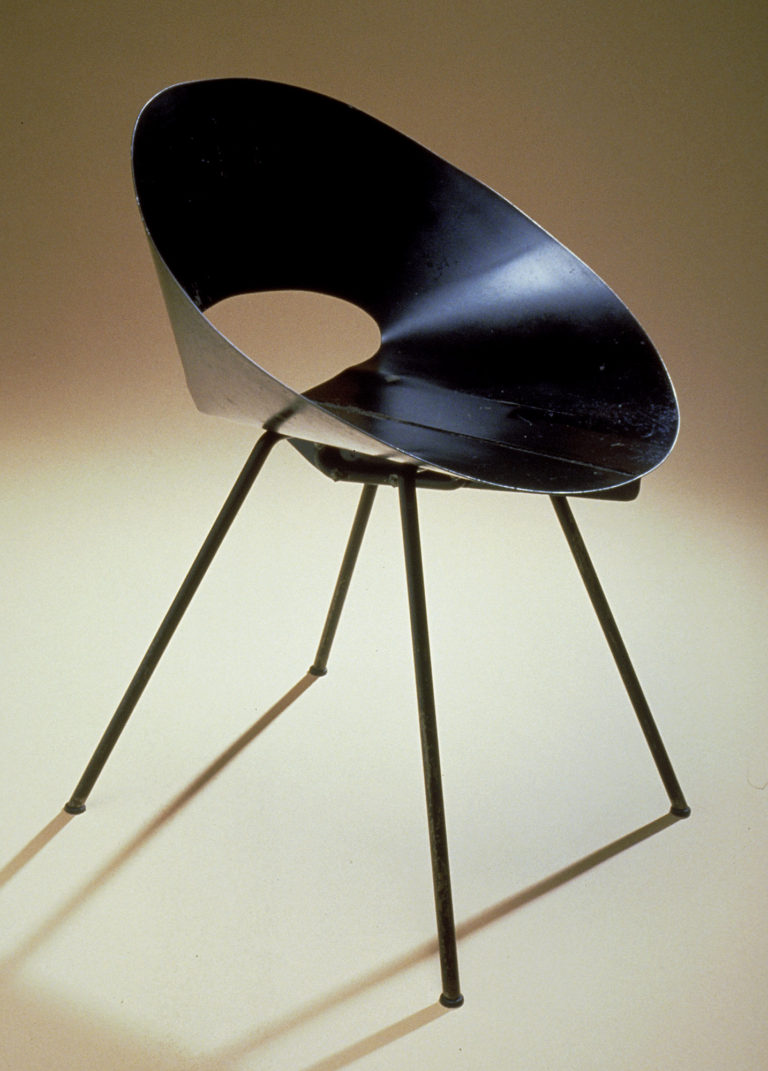 Chair with seat and back formed from sheet of black steel wrapped into a cone shape and four slanting legs.