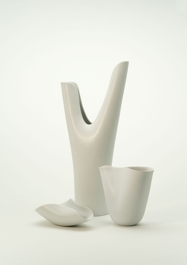 Two vases of different shapes and sizes and one bowl in off-white porcelain.