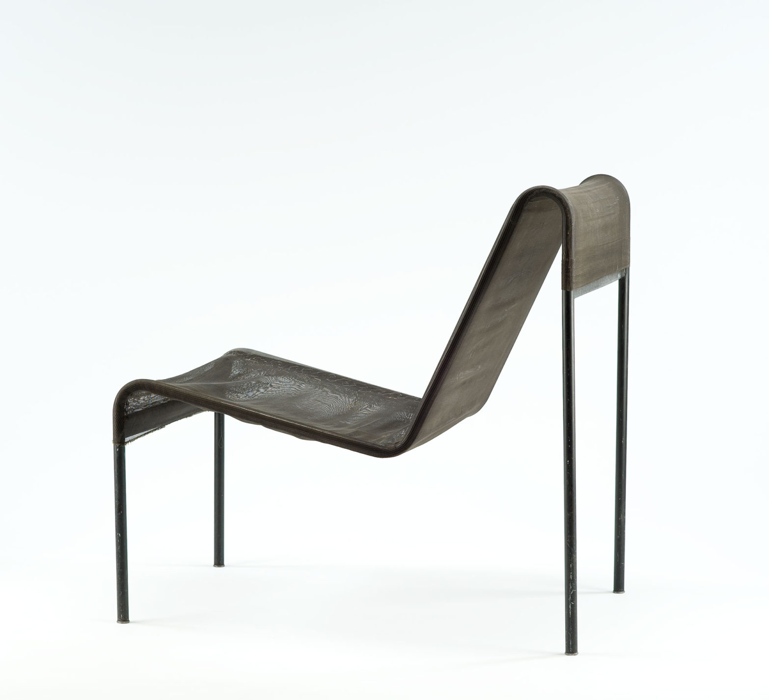 Black chair with nylon mesh upholstery stretched between the two continuous bars of the tubular-steel frame.