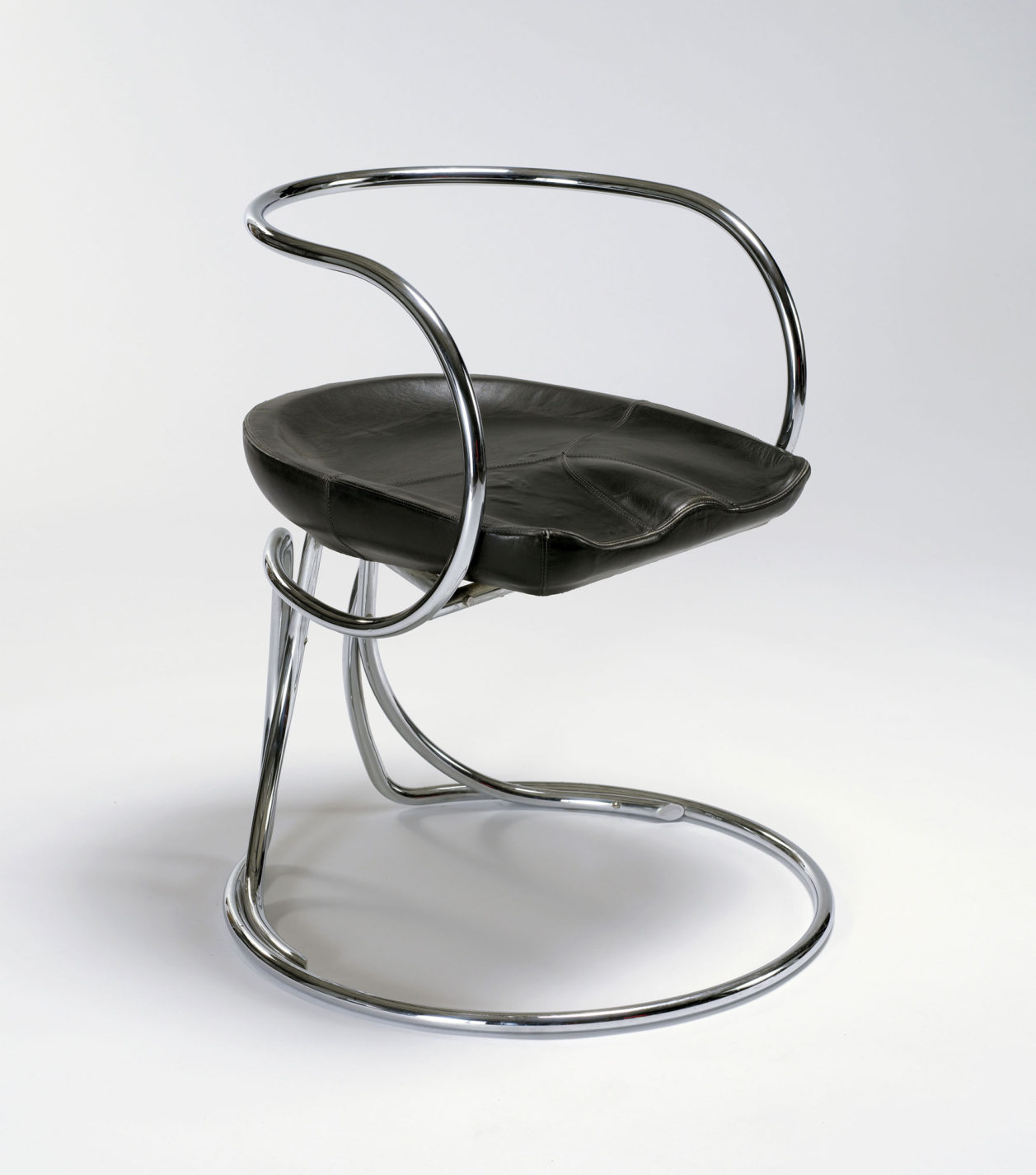 Chair with swirling tubular-steel frame and a shaped black seat cushion.