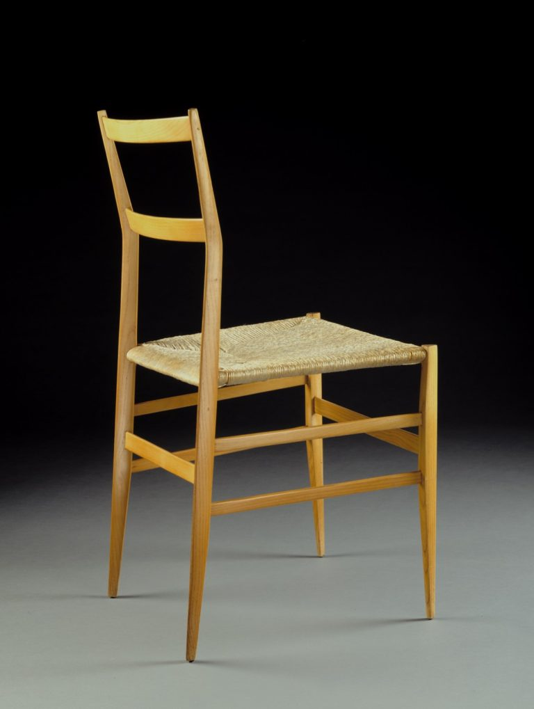 Wood chair with extremely slender legs and frame and a caned seat.