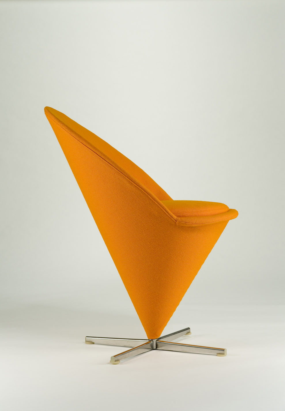 Bright orange conical chair with a crisscross steel base.