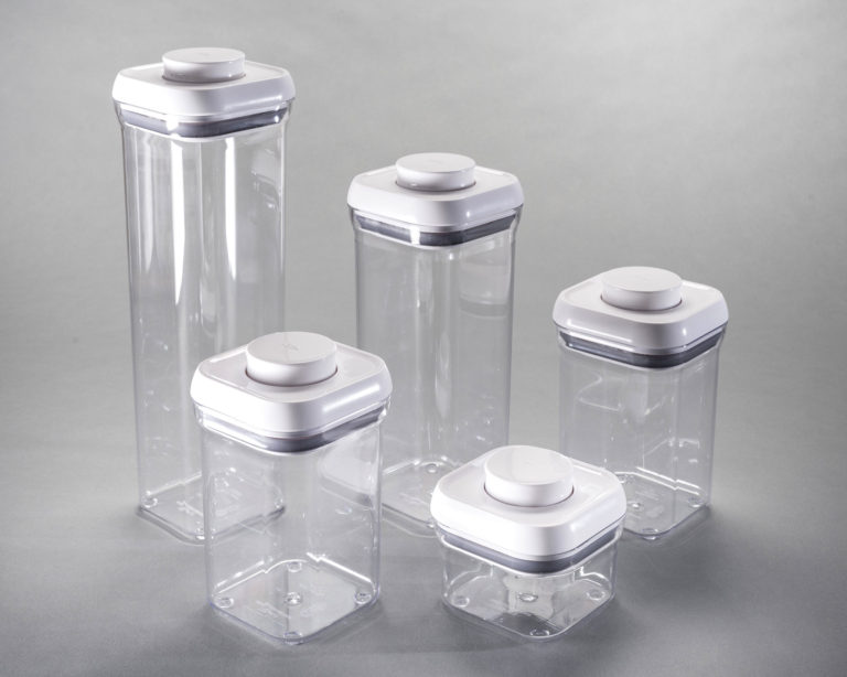 Set of rectangular, stackable, clear plastic containers with white lids.