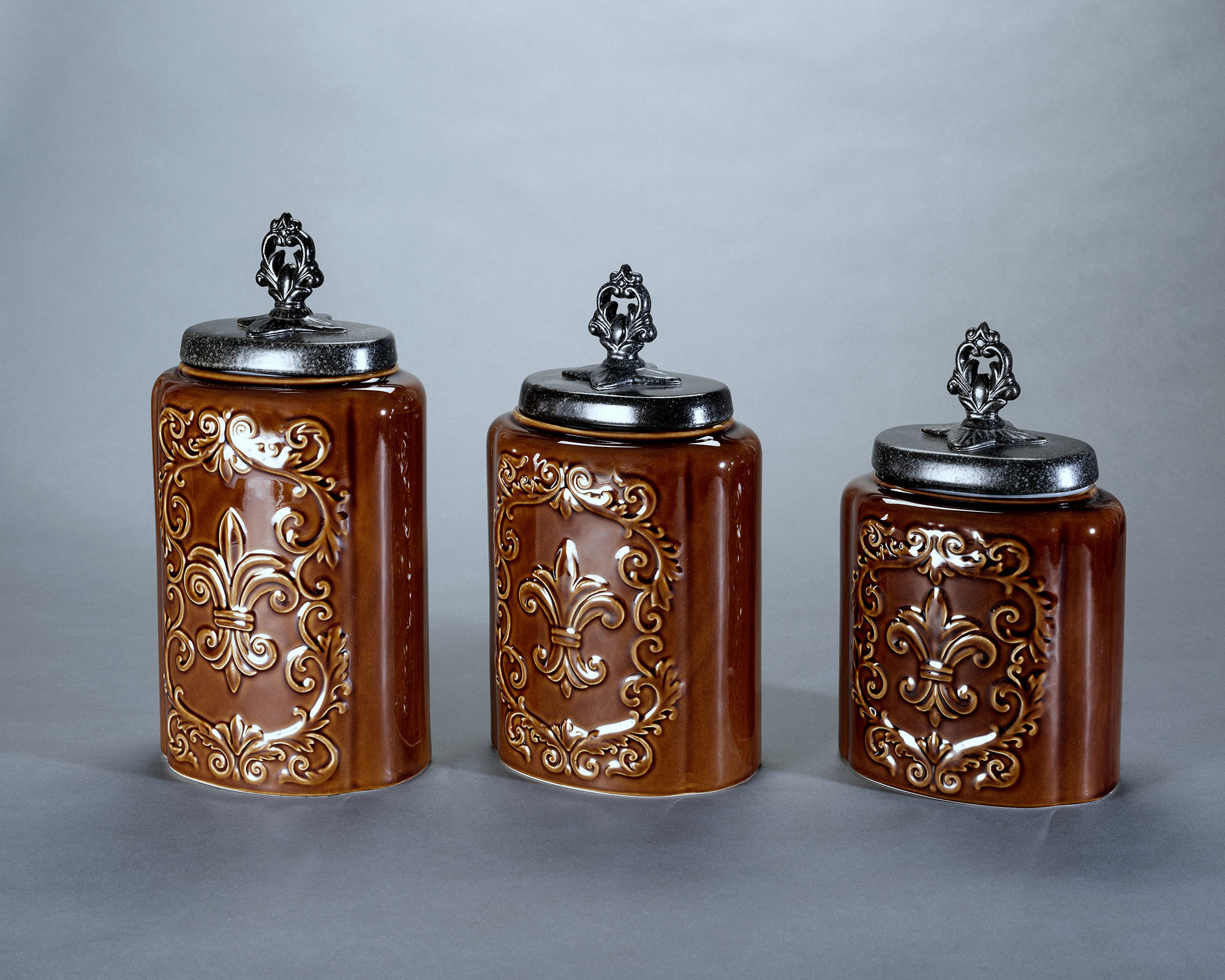 Set of ornately decorated, glazed ceramic containers with decorative finials.