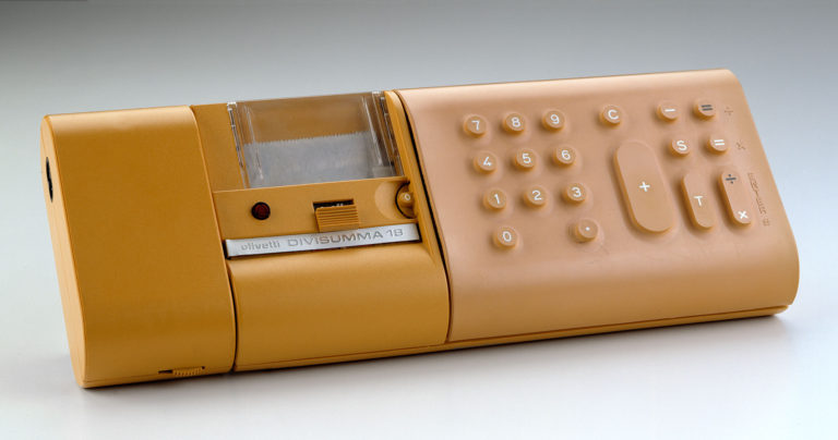 Horizontal rectangular calculator with rounded corners in yellow plastic and rubber. Buttons on right and printer section at center.