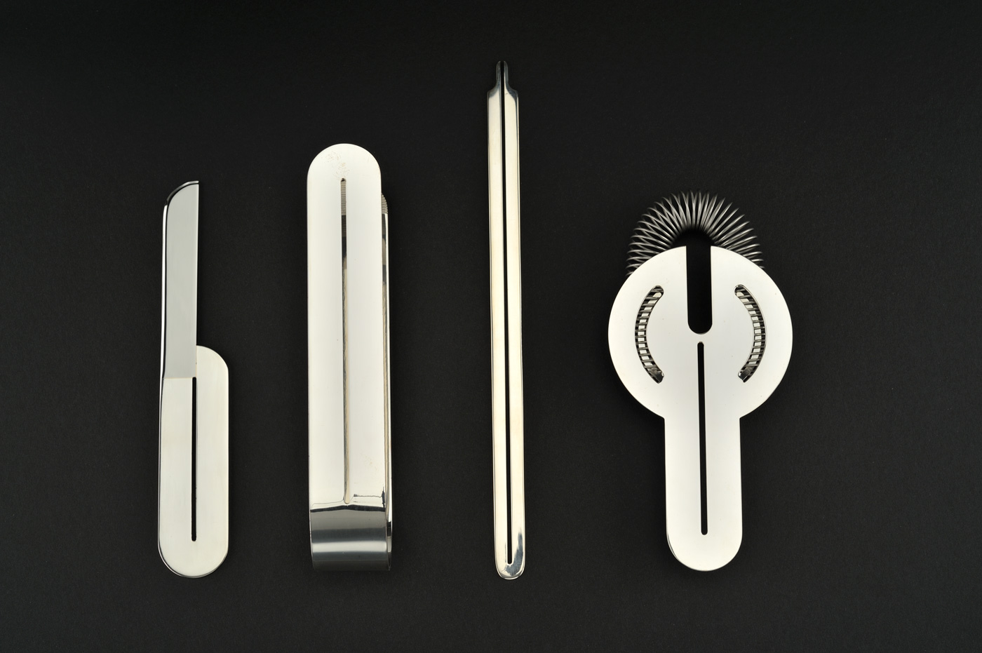 Set of four rounded and perforated bar tools in shining metal.
