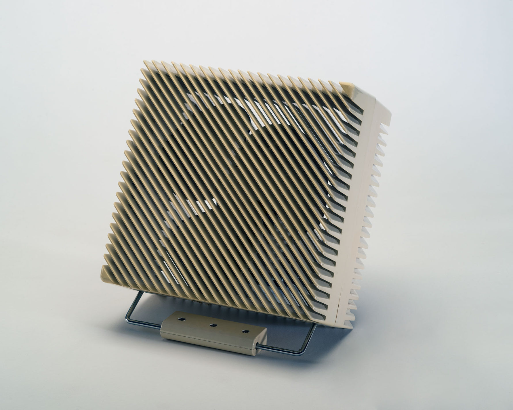 White square table fan with diagonal slats on the front of the casing.