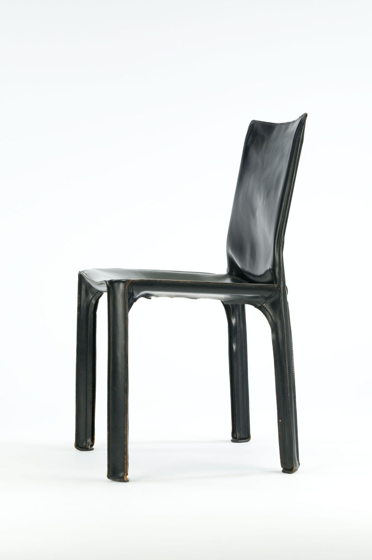 Simple four-legged side chair with full black leather slip cover.