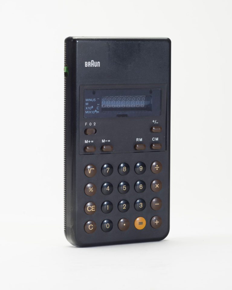 Black handheld calculator with digital display, brown switches, brown and black buttons with white markings, and a yellow button with a black equal sign.