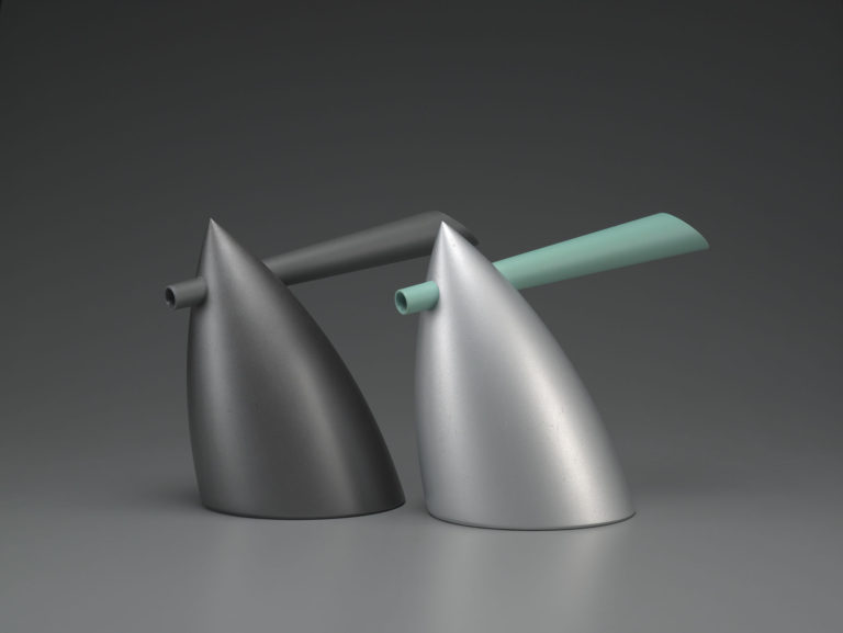 Two bullet-shaped kettles with a combined spout and handle that goes through the point at the top. One is all dark grey, the other is light gray with a pale blue-green spout/handle.