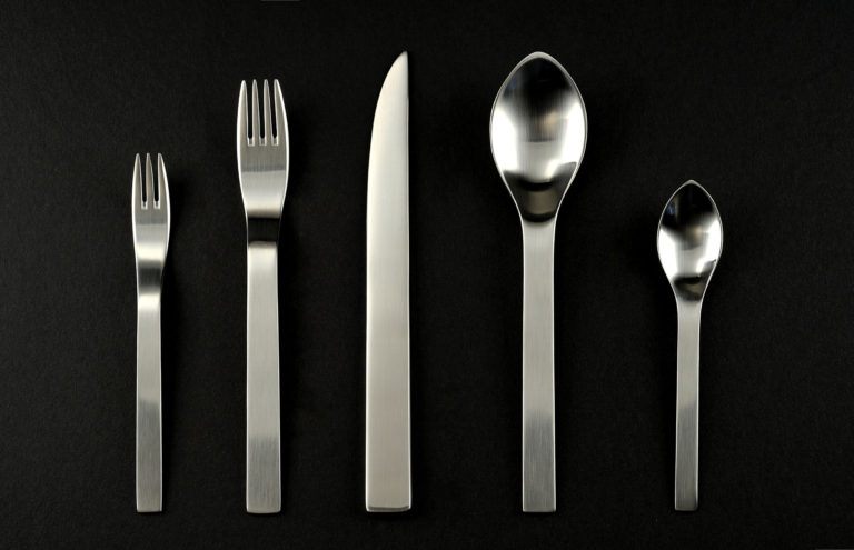 Set of steel flatware. Small and large forks, a knife, and small and large spoons.