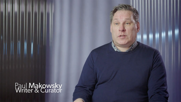 Still image of the interview with writer and curator Paul Makowsky