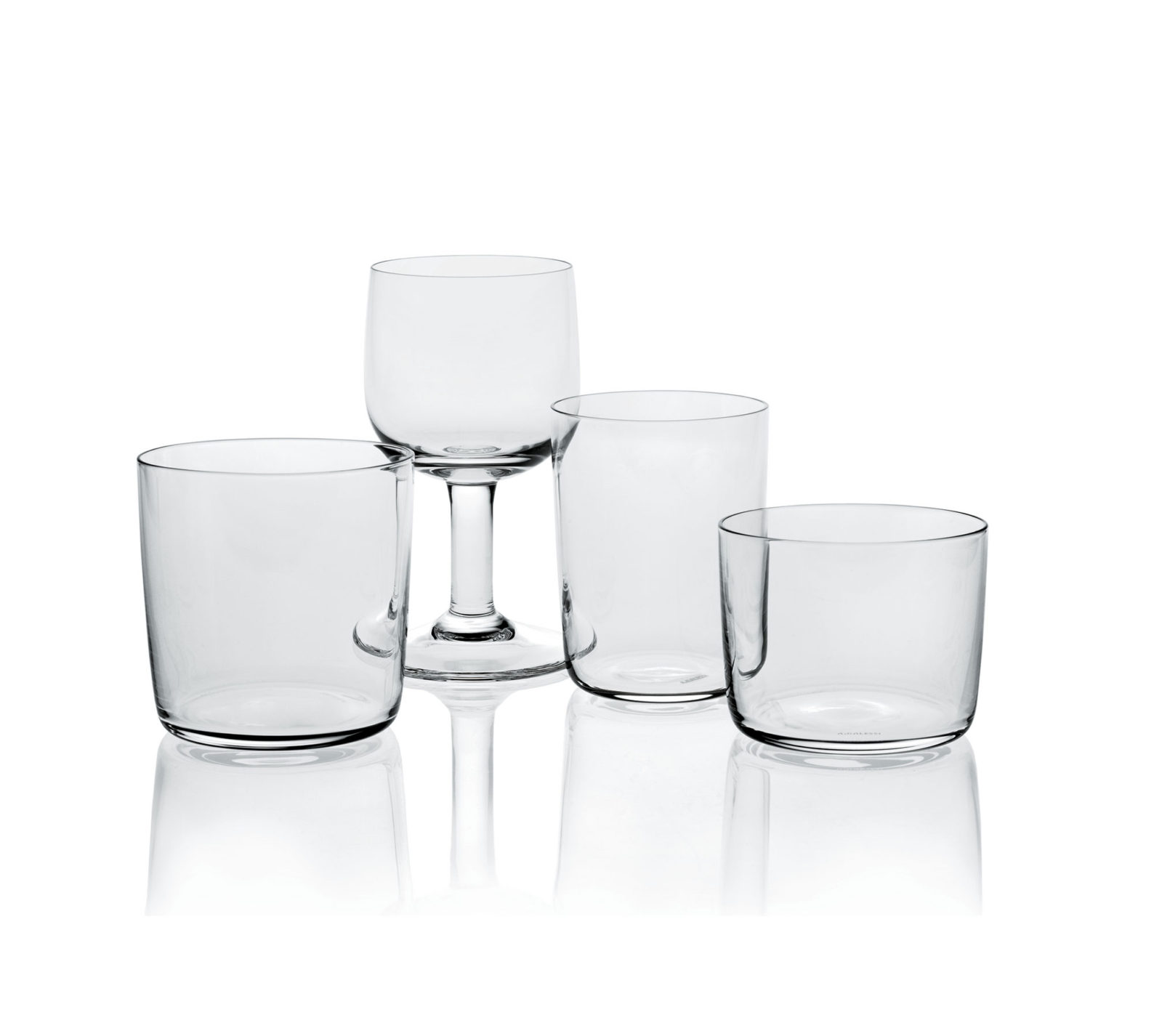 Four clear glasses. Three tumbler-shaped glasses of different sizes and one stemmed glass.