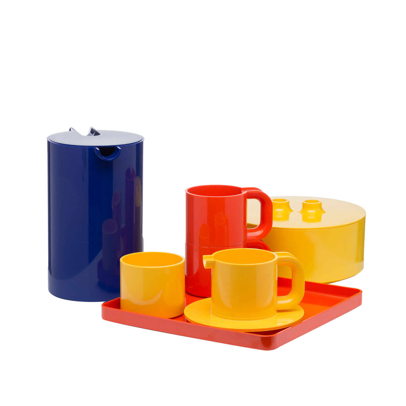 Set of brightly colored plastic dishes.  Cylindrical vessels with small circular plates and a rectangular tray in blue, orange, and yellow.