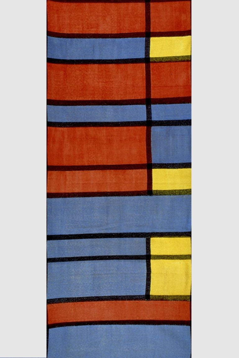 Textile with rectangles of red, blue, and yellow separated by black lines.