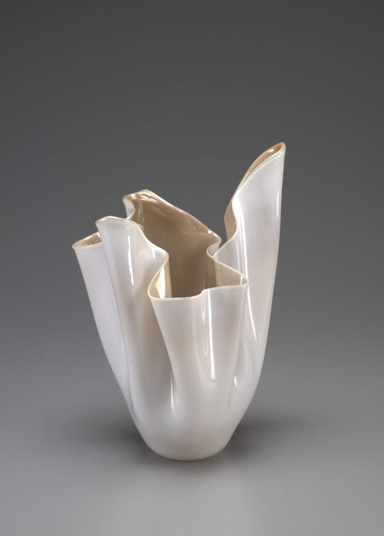 Glass vase resembling a draping piece of fabric viewed upside down.