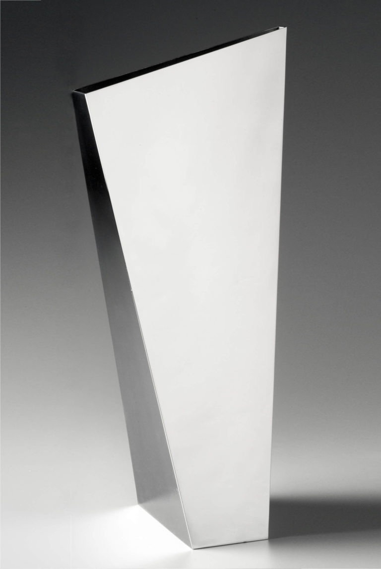 Angular metal vase, with every side a different-sized trapezoid.